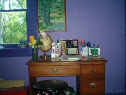 My daughter's study nook has supplies, artwork, and her favorite shade of purple!