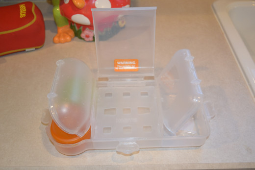 Each of the three compartment of the Food Mover lunch box has an easy to open latch