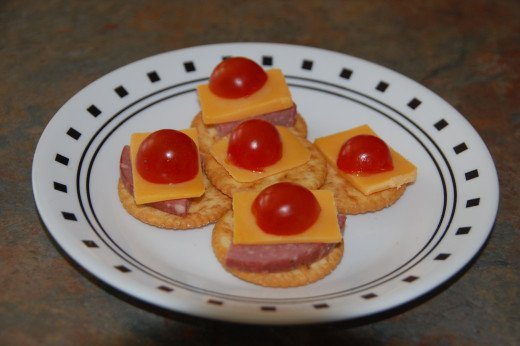 Cherry tomatoes with cheddar cheese and summer sausage