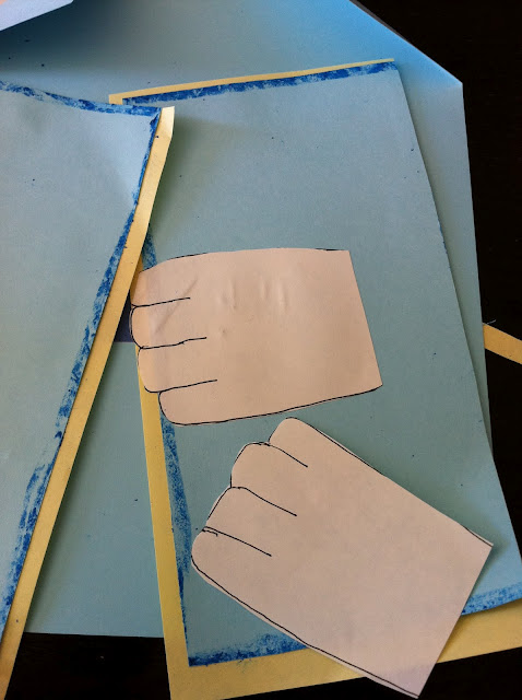 Cut out hand shapes and glue them onto a triangular cut cardstock that fits the shape of the card, creating an opened shirt look.