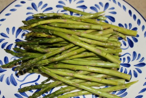 Put prepped asparagus spears on a plate