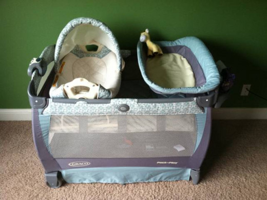 Pack n Play with changer, bassinet, and side caddy... it also vibrates and plays music