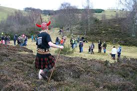 The Hunt Leader surveys his team while wearing a Viking helmet