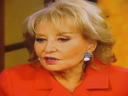 Barbara  Walters talks with other ladies.