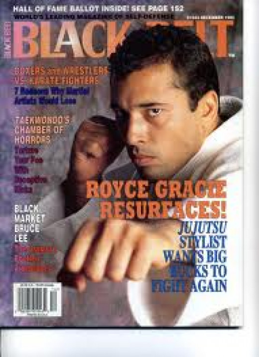 Royce Gracie was a pioneer in the UFC and he has won the light heavyweight and heavyweight championships.  Not to mention the first two UFC Championships.