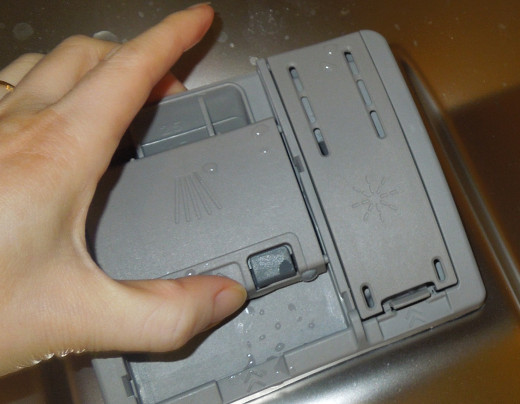 Closing A Dishwasher Detergent Dispenser After Putting in A Dishwasher Detergent Tablet