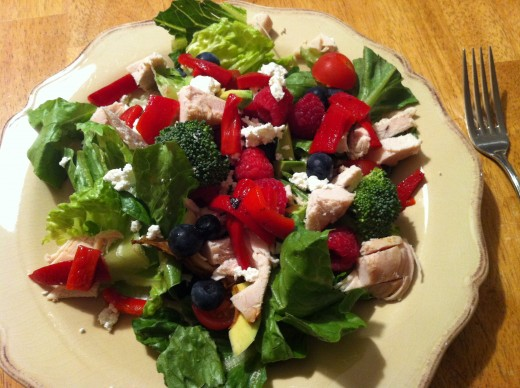 Salads loaded with a variety of fruits and vegetables can be delicious and healthy.