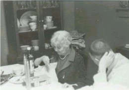 My brother and grandmother talking  while enjoying Sunday Dinner
