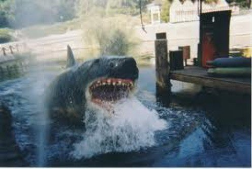 Jaws: The Ride is located in Orlando, Florida. Each person rides a boat that Jaws attacks. It has a guide driving the boat.