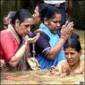 Hindu Women Pray As They Immerse Themselves In The Ganga River