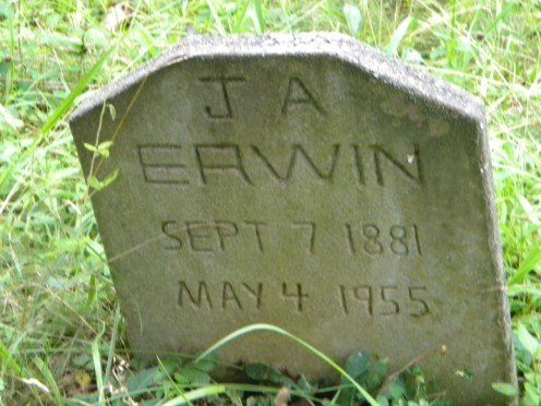 The tombstone, made by James L. Erwin, may be leaning but it is still standing in the family cemetery.
