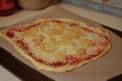 Example of a pizza with not enough cheese or toppings. A real pizza travesty.