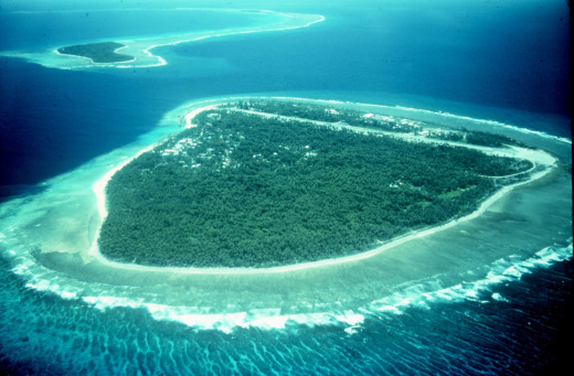 Island with fringing reef off Yap, Micronesia
