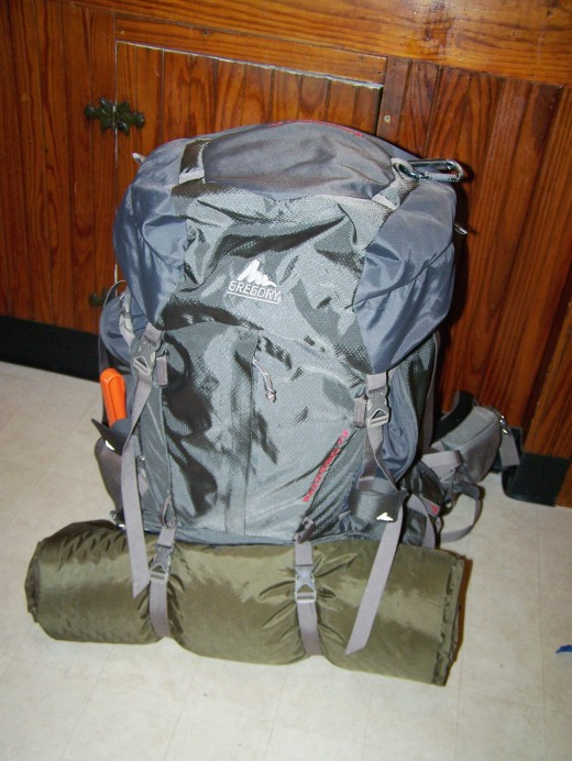 A pack with all the compression straps buckled and tightened. The sleeping mat is also strapped the outside of the sleeping bag compartment in order to save space within the bag.