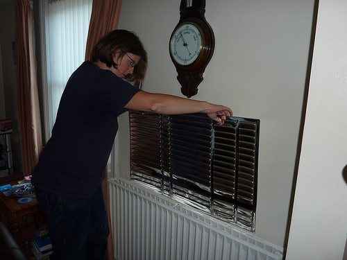 An example of a radiator panel being inserted, possibly using sticky tape