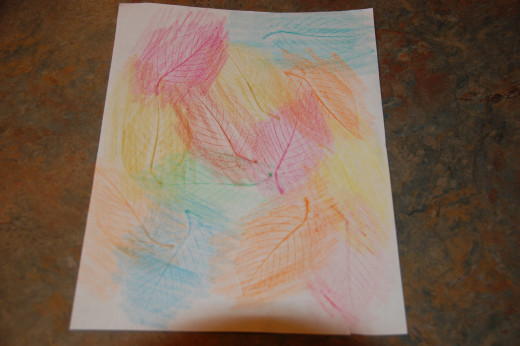leaf rubbings with crayon on white paper