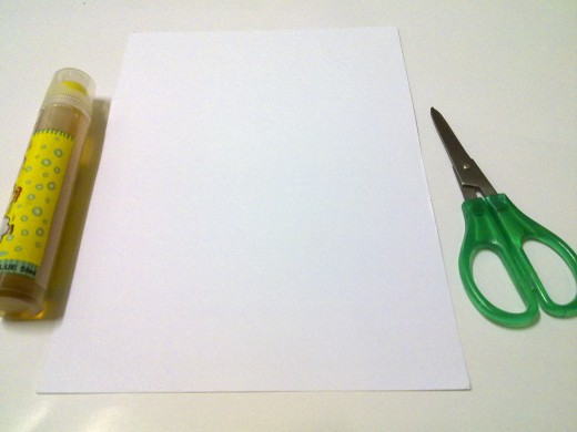 glue, white card and a pair of sharp scissors