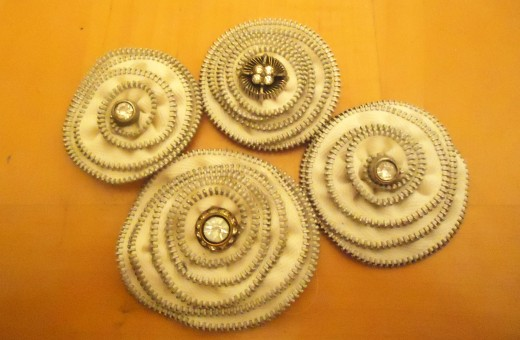 cream colored zipper flowers with antique button centers