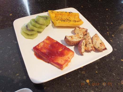 The squash is creamy and sweet, the potatoes are browned and delicious, and the tofu  has a nice chew with the excellent barbecue flavor and the kiwi clears the palate.