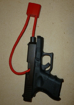 My Glock with magazine removed and gunlock provided with gun.