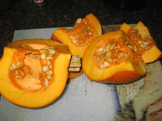 Slice pumpkin into sections.