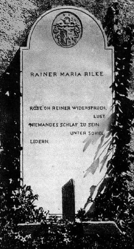 Rilke's grave in Raron, Switzerland (note how the word Reiner is used to echo his name)