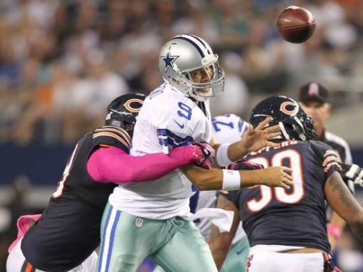 Romo is pressured by a Bears defender