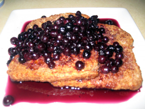 guilt-free french toast with frozen organic wild blueberries and blueberry maple syrup sauce.