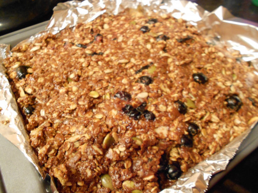 Home made protein bar packed with fruit, seeds, granoloa and chocolate