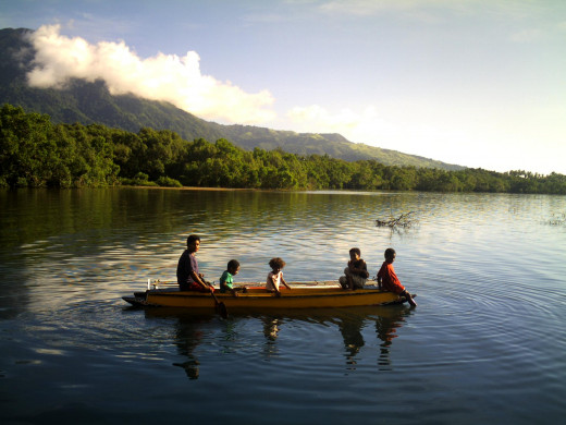 Canoes, used widely around the island to move from place to place, Goodenough Island, PNG