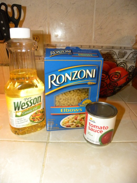 Elbow Macaroni Oil Tomato Sauce Seasoning...salt, chicken cube...whatever you like (best if salt based)