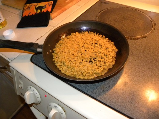 Add about 1 cup of noodles to hot oil, oil should coat all noodles Keep stirring noodles so they dont burn