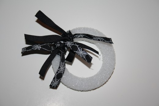 Starting with the spiderweb ribbon on the mini wreath