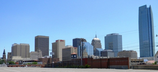 Oklahoma City downtown area, looking southeast.  A recently completed Devon Tower on the right took away lots of needed parking for downtown area, which is an ongoing unmet need.  At extreme left is church spire by OKC National Memorial.
