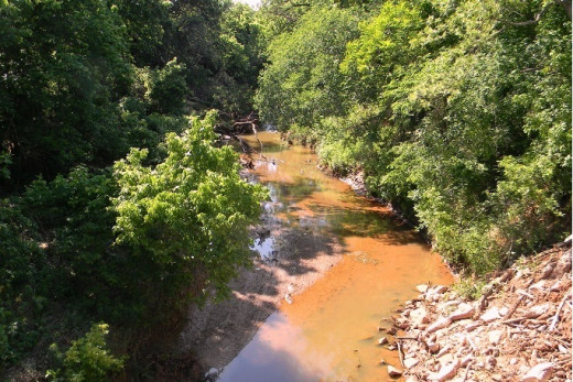 This red dirt/water stream will fill and roar when it rains enough.  When...if...and it will, eventually.