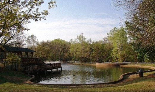 Hafer Park fishing pond and trails is a popular summer time picnic and exercise area.