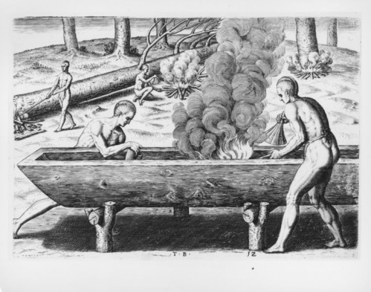 Native Americans making a dugout with fire. Lewis and Clark used similar canoes during their famous expedition.