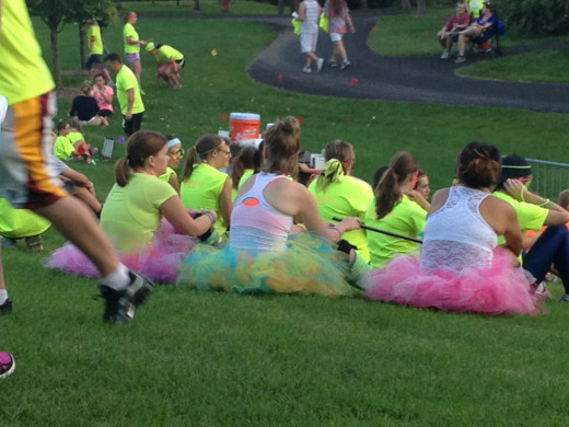 Glow-stick skeletons, electric Rainbow Brights, and lots of tutus were seen in the crowd. Thinking a fun costume is a must for next year.