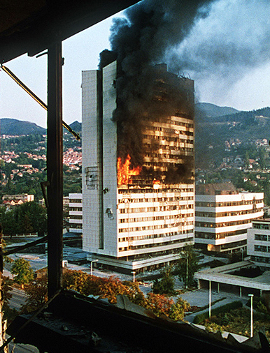 The Bosnian Parliament building under siege during the 1992 war.