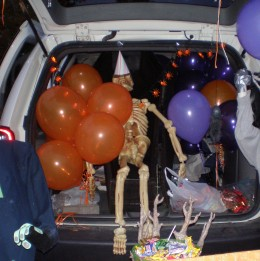 Create a Halloween party in your car with balloons, lights, and party hats for all the monsters!