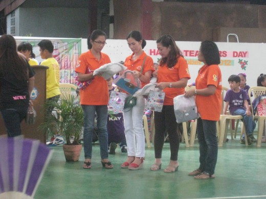 Teachers receiving flowers and gifts