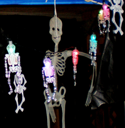 Colorful skeleton lights hang from the low ceiling in this haunted house.