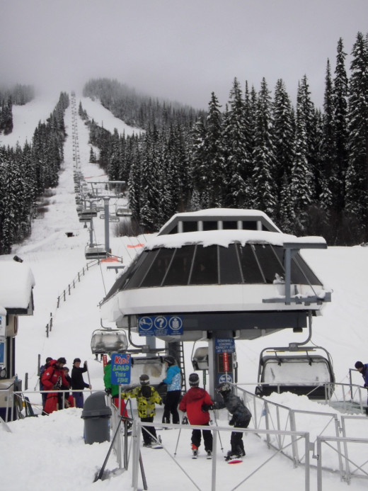Families on skis and snowboards move quickly in line at Sunburst Chairlift. Sun Peaks is BC's second largest ski terrain after Whistler, home of the Winter 2010 Olympics.