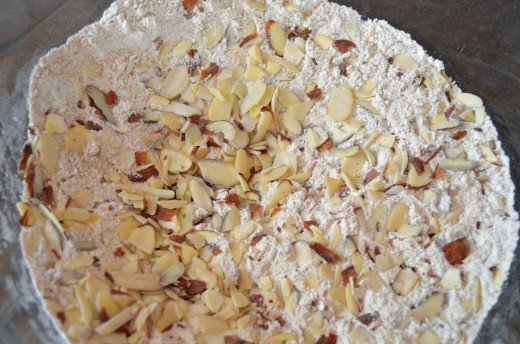 Sprinkle sliced nuts on top of dry ingredients and stir gently to combine.