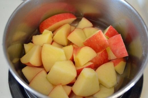 If using organic fruit, I leave the skin on--chunk or dice according to preference.  Apples can also be cooked in a bit of apple juice for more flavor.