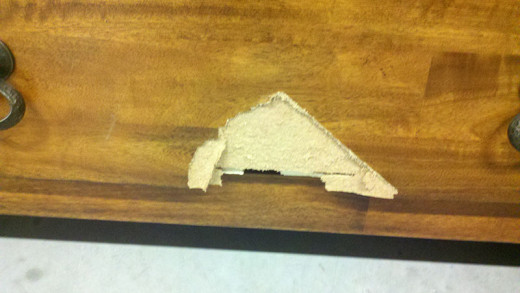Cheaply made particle board furniture chips out and can't be repaired