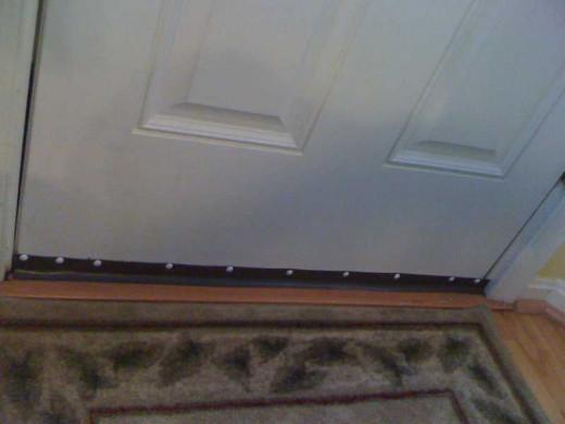 Fig 5.  Door Bottom Secured with Tacks