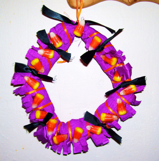 For this tutorial, a step-by-step guide to a candy corn wreath.