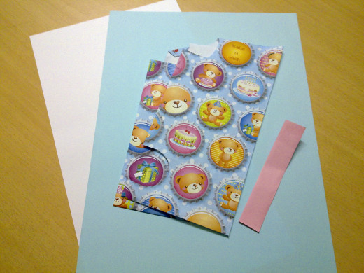 white card, color construction paper and gift wrapper