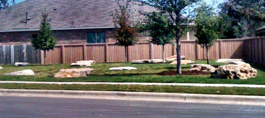 A green space in a newly developing neighborhood. Still under construction, this area was the first to be completed. Entering the neighborhood, it catches the eye.